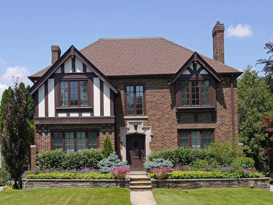 5 home siding materials that go with brick alair homes for Tudor siding panels