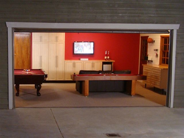 Convert your garage into a high tech playroom alair homes for How much to add a room above garage